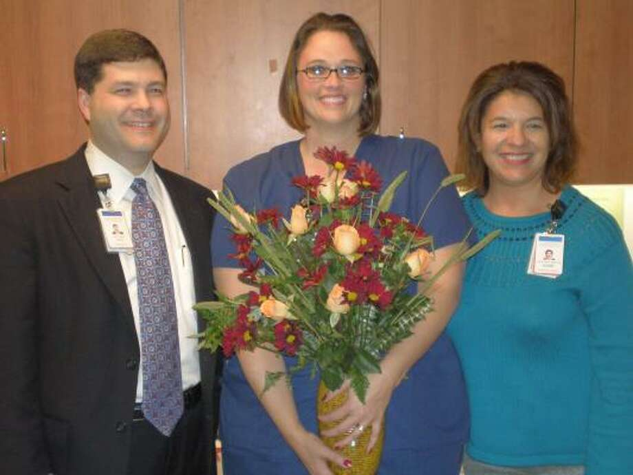 ANNUAL HONOR: Memorial Hermann Northeast CEO Louis Smith; left, joins Mary Box, employee of the year; and Suzanne Croft, directory of the Cardiopulmonary Department.
