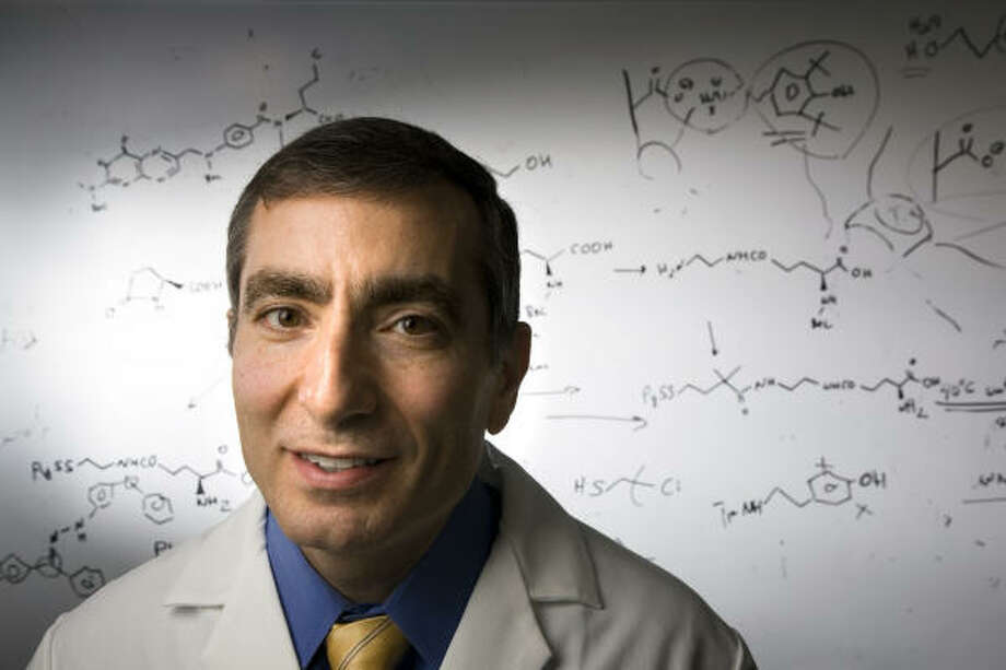 Jim Tour, shown in his lab at Rice University, is working to develop a drug compound to protect people against radiation poisoning. Photo: Smiley N. Pool, Chronicle
