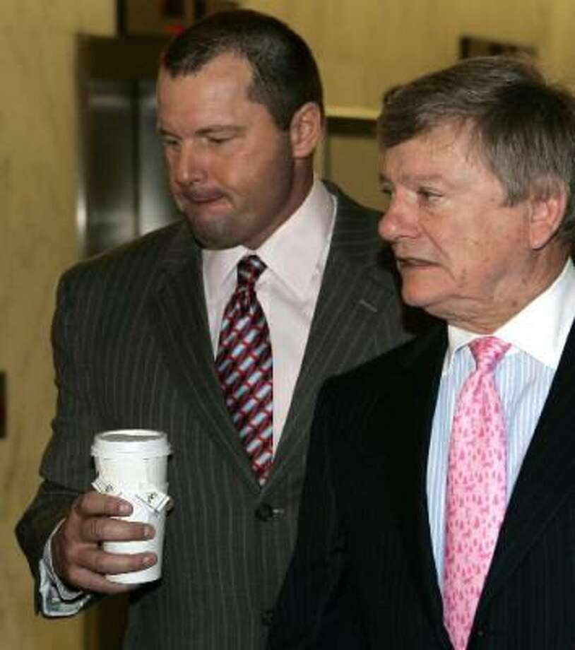 Pitcher Roger Clemens, left, accompanied by his attorney Rusty Hardin, arrives on Capitol Hill. Photo: AP