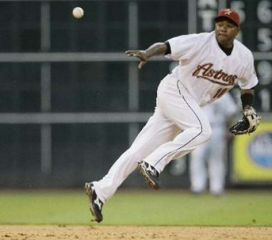 Miguel Tejada makes a play in the fifth. Photo: Melissa Phillip, Chronicle