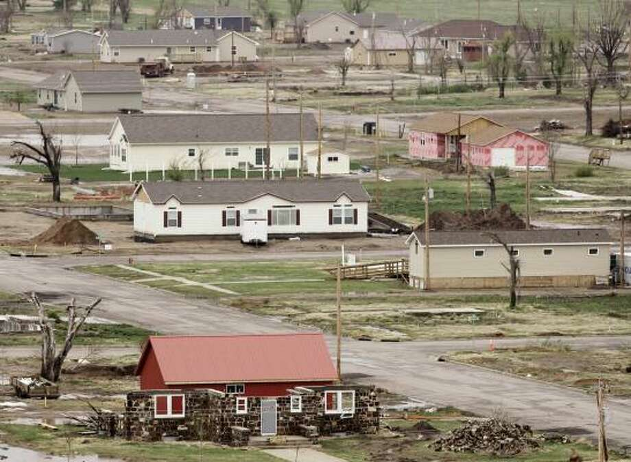 Energy efficient houses in various stages of construction dot the landscape in Greensburg, Kan., a town of 1,400. Photo: CHARLIE RIEDEL, ASSOCIATED PRESS