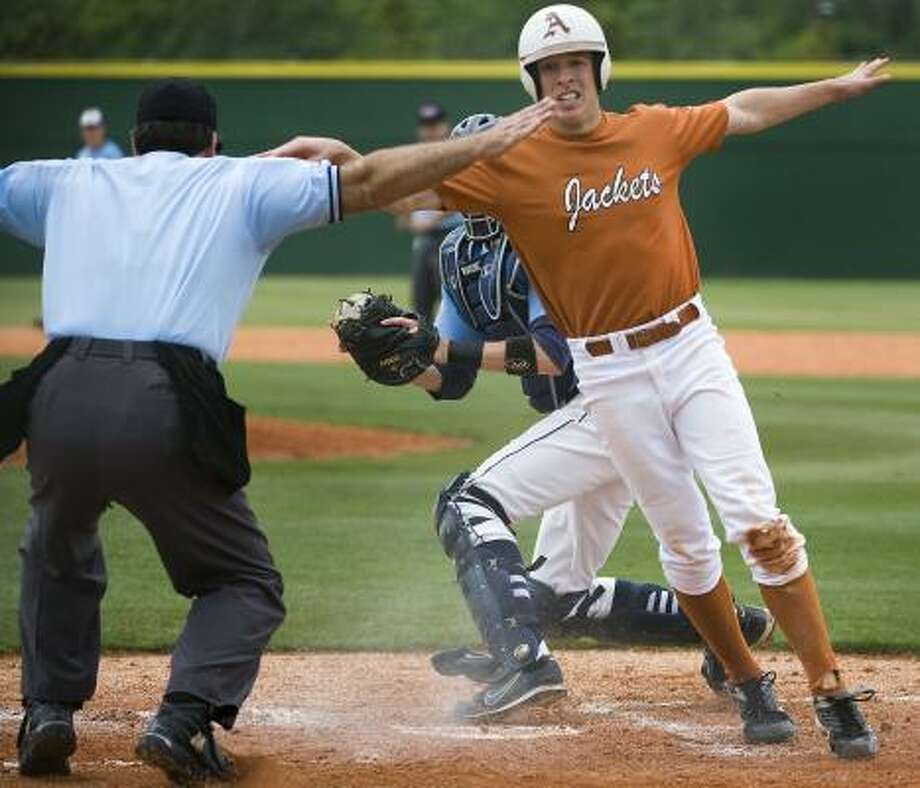 Alvin's Kevin Martin agrees with the umpire's call as he scores on Moe Guisto's single in the third inning of the Yellowjackets' 4-3 Class 5A playoff victory over Brazoswood. Photo: SMILEY N. POOL, CHRONICLE