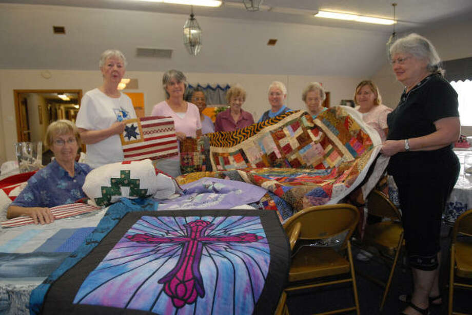 Verla Perry, Kay Beggs, Jeanne Little, Yvonne Jack, Mary Lou Gaus, Jo Ann Criste, Carolyn Cornett, Susan Veres and Joan Mickler hold some of the quilt they have made as a part of their Be Pieceful quilting group at Friends Church in Friendswood.  The quilted bee project donated 47 quilts to the VA Hospital in Houston. Photo: Kim Christensen, Freelance