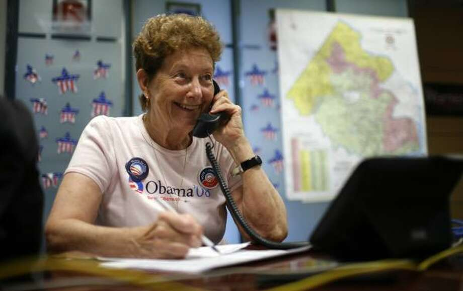 Rosie Engman, a retired teacher and delegate to the Democratic National Convention, takes a call in McLean, Va., last week. Engman lives more frugally in retirement, growing her own vegetables and combining errands to save gasoline. Photo: LAWRENCE JACKSON, ASSOCIATED PRESS