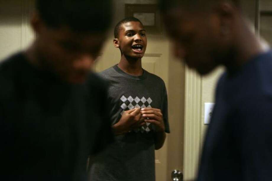 Renaul Long, 14, runs through his impromptu presentation. Photo: Eric Kayne, Chronicle