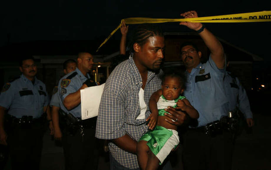 Fritzvoneric Brantley cradles his daughter, 21-month-old Jakaila, as she's returned to her family on Friday. Photo: James Nielsen, Chronicle