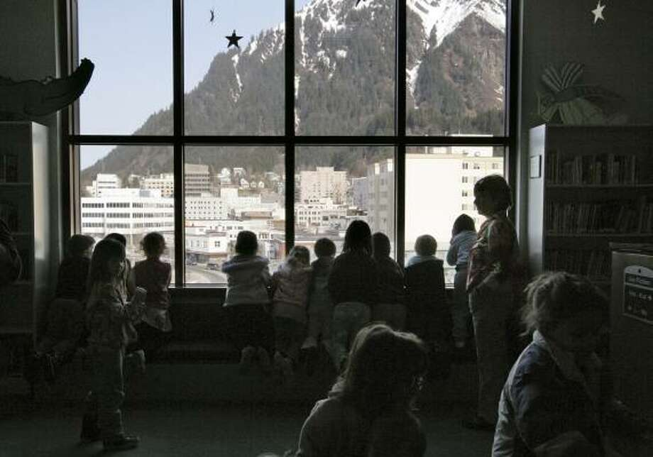 Preschool students look at Mount Juneau from the capital city's darkened public library last month. Avalanches knocked out transmission lines and cut off hydroelectric power. Photo: SEANNA O'SULLIVAN, ASSOCIATED PRESS
