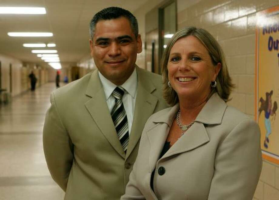 Rolando Treviño, who'll head the ninth-grade students at Sam Houston High School, and Jane Crump, who'll be in charge of grades 10-12, want to get students excited again about learning. Photo: STEVE CAMPBELL, CHRONICLE