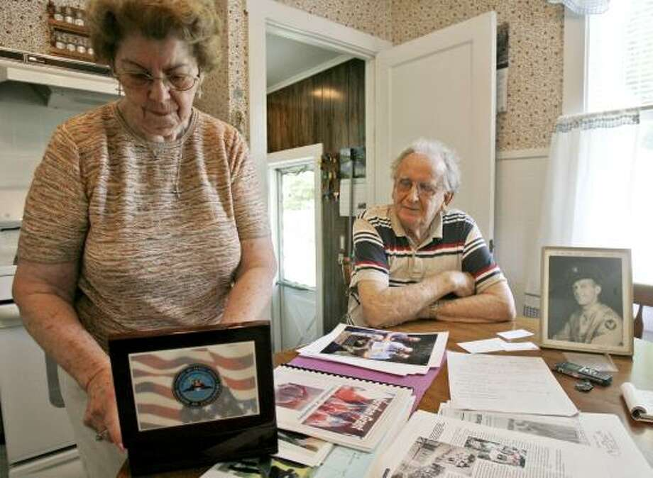 Charles Shostak and his wife, Mary, keep his brother's dog tag and ring in a box with other personal mementos. Photo: TOBY TALBOT PHOTOS, ASSOCIATED PRESS