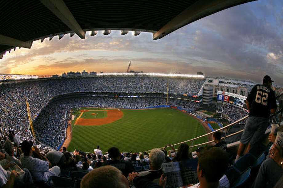The sun sets behind Yankee Stadium on Sunday. Photo: Julie Jacobson, AP