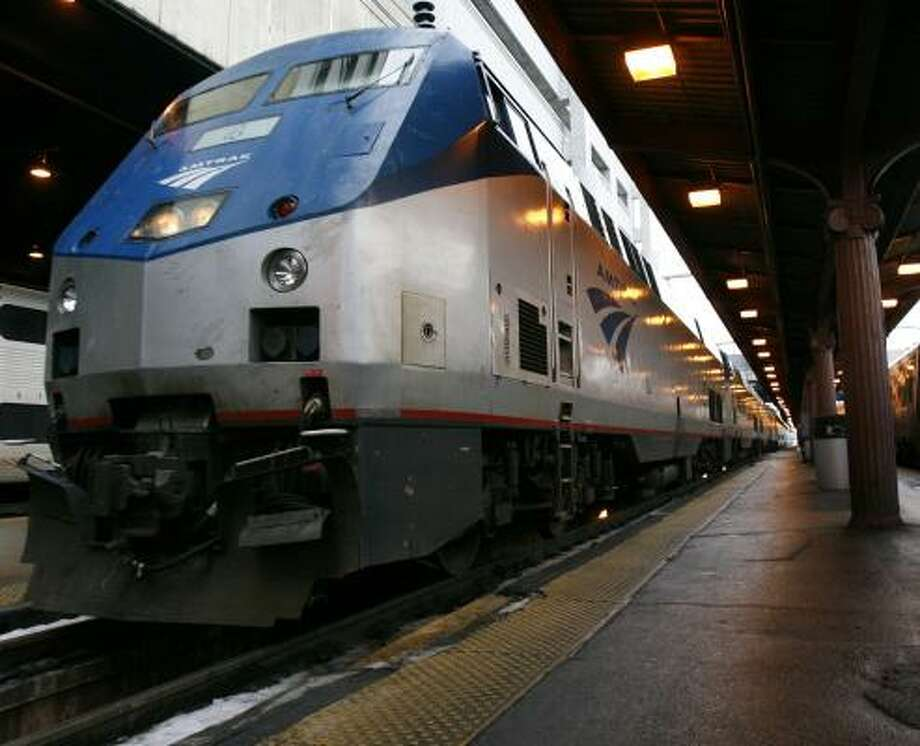 With the high cost of energy and congestion on highways and at airports, passenger trains, like the Capitol Limited Amtrak train above, are gaining ground in Congress. Photo: JACQUELYN MARTIN, ASSOCIATED PRESS