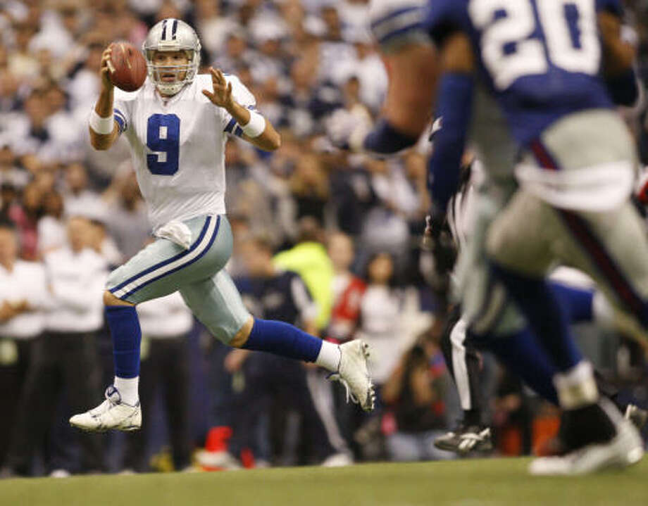 Tony Romo threw two touchdowns as the Dallas defense dominated Eli Manning and the Giants. Photo: Ron T. Ennis, MCT