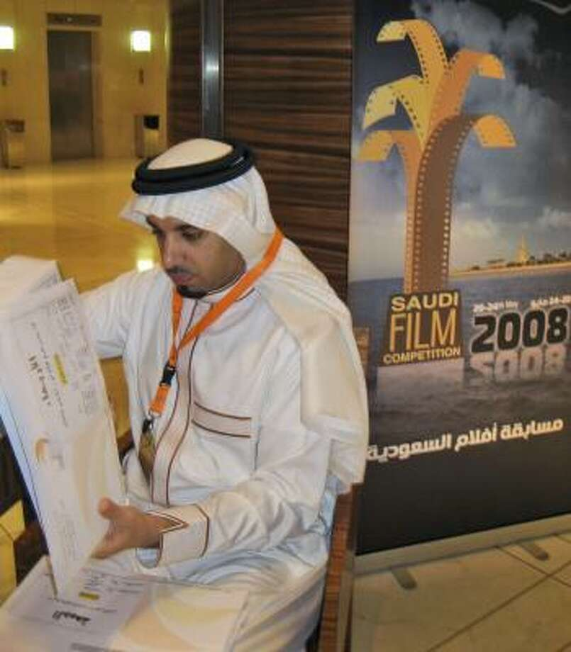 Atef al-Ghanem, head of the festival cultural committee, goes over plans. Photo: DONNA ABU-NASR, ASSOCIATED PRESS