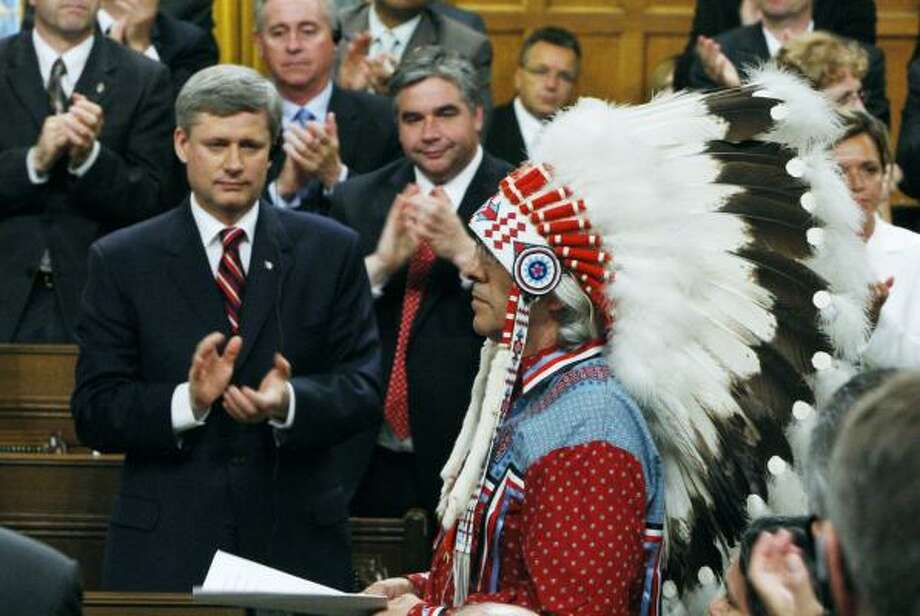 Canadian Prime Minister Stephen Harper and other legislators give Assembly of First Nations Chief Phil Fontaine a standing ovation as he rises to respond to the official apology. Photo: CHRIS WATTIE, CANADIAN PRESS
