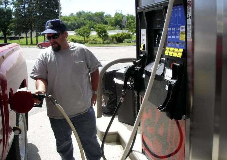Rodney Gaffney fills his flexible-fuel pickup with E30 gasoline in Granite Falls, Minn. Gaffney says he also uses ethanol blends in his 1997 Buick, though auto manufacturers warn that ethanol can corrode fuel lines and cause other damage in cars not designed to carry the fuel. Photo: ELIZABETH DUNBAR, ASSOCIATED PRESS