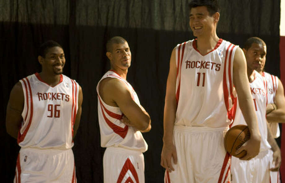 Rockets teammates Ron Artest, from left, Shane Battier, Yao Ming and Tracy McGrady were back in uniform for the team's media day Monday at Toyota Center. Photo: James Nielsen, Chronicle