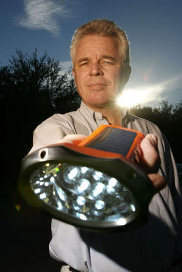 Mark Bent, president and chief executive officer of SunNight Solar, shows off the BoGo Solar Task Light. The solar-powered flashlights, which are distributed to refugee camps throughout Africa, provide eight hours of light after they are charged. The batteries work everyday for three years before they need to be replaced. Photo: Johnny Hanson, Houston Chronicle