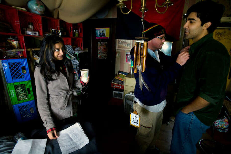 Noureen DeWulf and Bobby Naderi, both actors, with Jay Verkamp, center, the sound mixer for the film version of Michael Muhammad Knight's novel, The Taqwacores, prepare for a scene on the set in Cleveland. A college professor has called Knight's novel The Catcher in the Rye for young Muslims. Photo: DAVID AHNTHOLZ, NYT
