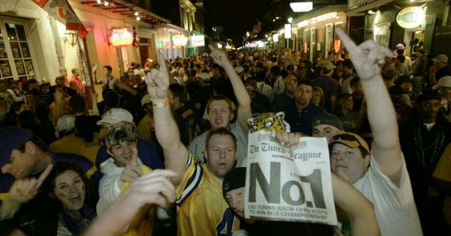 LSU fans flood the French Quarter early Tuesday morning in celebration of a second BCS title in five years. Photo: KEITH SRAKOCIC, ASSOCIATED PRESS