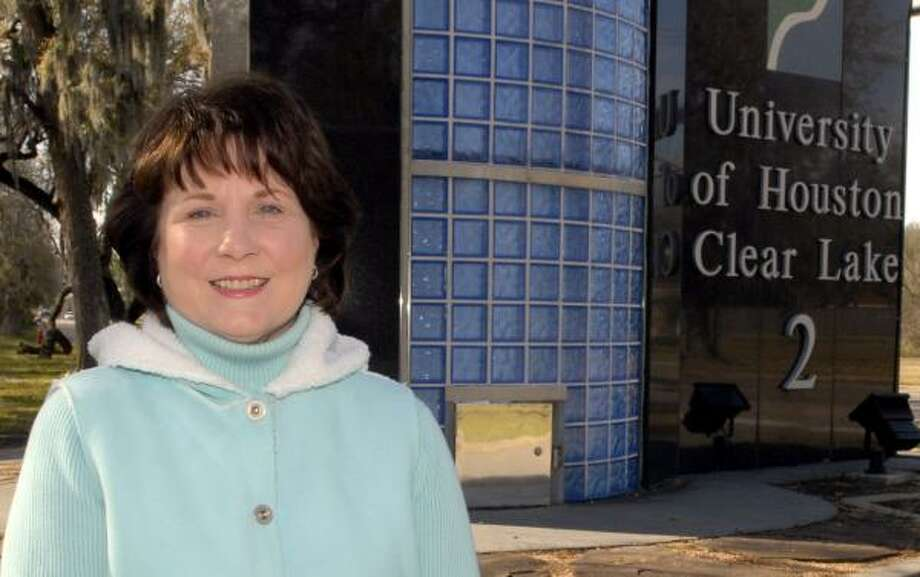 Judy Hughes stands outside the University of Houston-Clear Lake, where she earned a bachelor's degree in psychology. Photo: KIM CHRISTENSEN, FOR THE CHRONICLE
