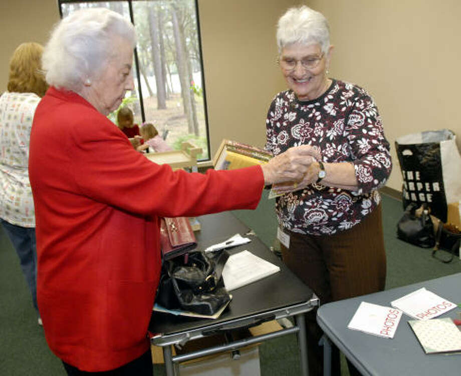 Mary Hanson buys a book from Dorothy Churchill at the Emmanuel Episcopal Church Fundraiser. Photo: Kim Christensen, For The Chronicle