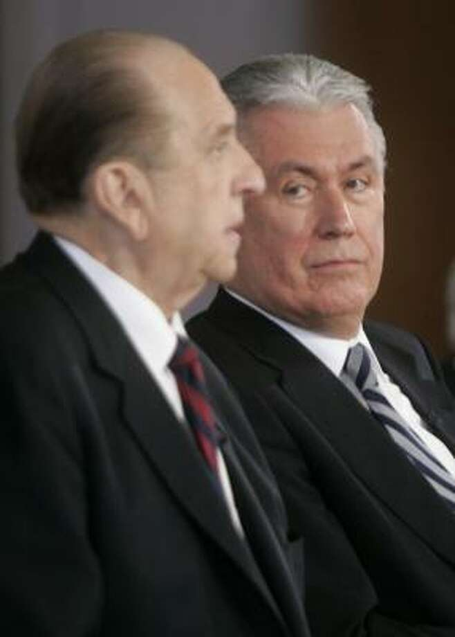 Dieter Uchtdorf, right, listens to Thomas S. Monson. Photo: DOUGLAS C. PIZAC, ASSOCIATED PRESS