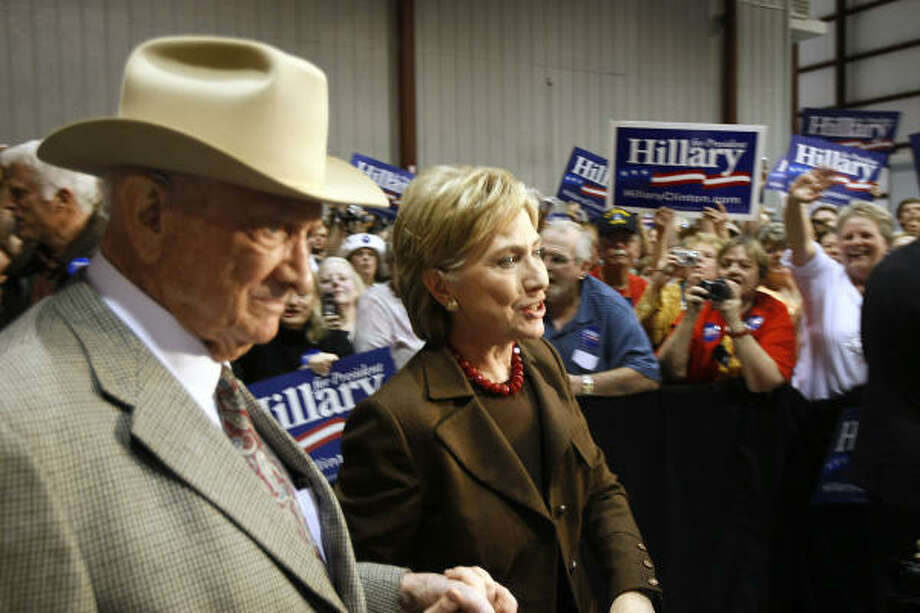 Democratic presidential candidate Sen. Hillary Rodham Clinton is escorted onto the stage by former Texas Congressman Jack Brooks, left, at a campaign rally at an airport hangar in Beaumont today. Photo: ROBYN BECK, AFP/Getty Images