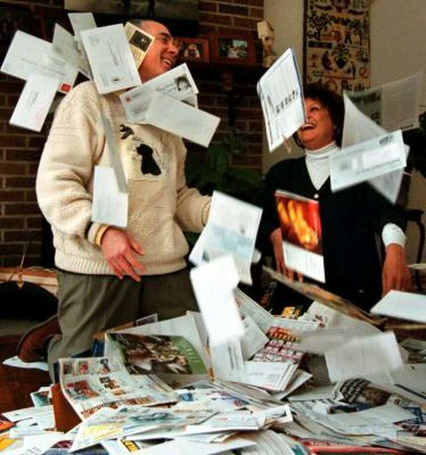Maurice and Elfi Fliess of Reston, Va., wallowed in a year's worth of fliers and catalogs — 65 pounds worth — in 2000. Photo: DAYNA SMITH, WASHINGTON POST FILE