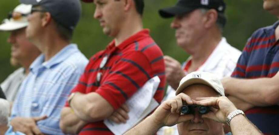 Good binoculars can be a boon in the gallery. Photo: KAREN WARREN, CHRONICLE