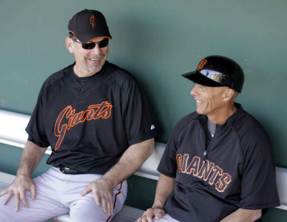 San Francisco third-base caoch Tim Flannery, right, wants some clarification on new rules for base coaches. Photo: Eric Risberg, AP