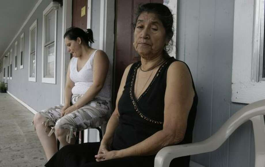 Alma Baladez, 34, left, with Teresa Perez, 64, says the arrests at the Shipley compound across from her apartment have sent many undocumented workers into hiding. Photo: JULIO CORTEZ, CHRONICLE