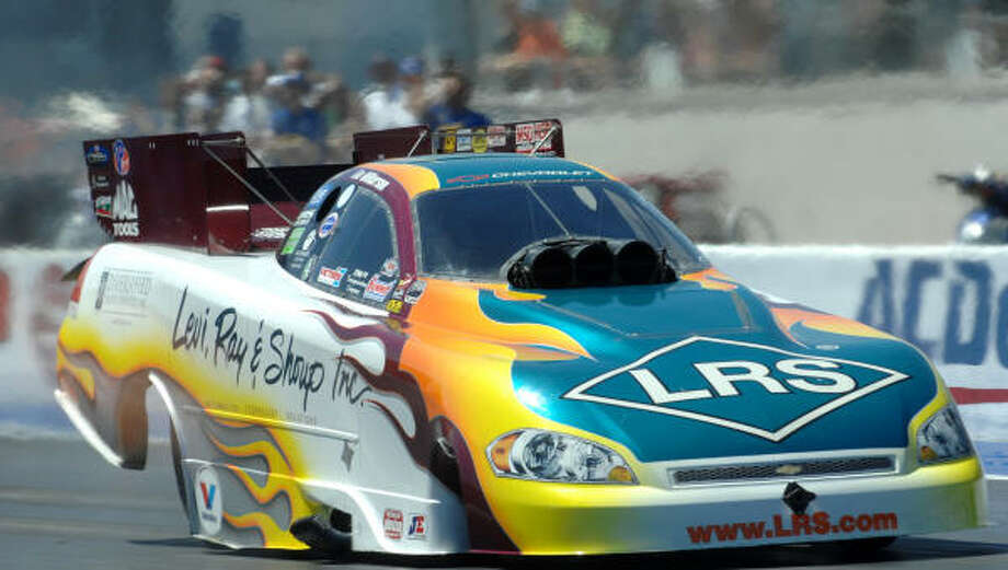 Tim Wilkerson wins the Funny Car class at the NHRA's SummitRacing.com Nationals drag race Sunday. Photo: AP