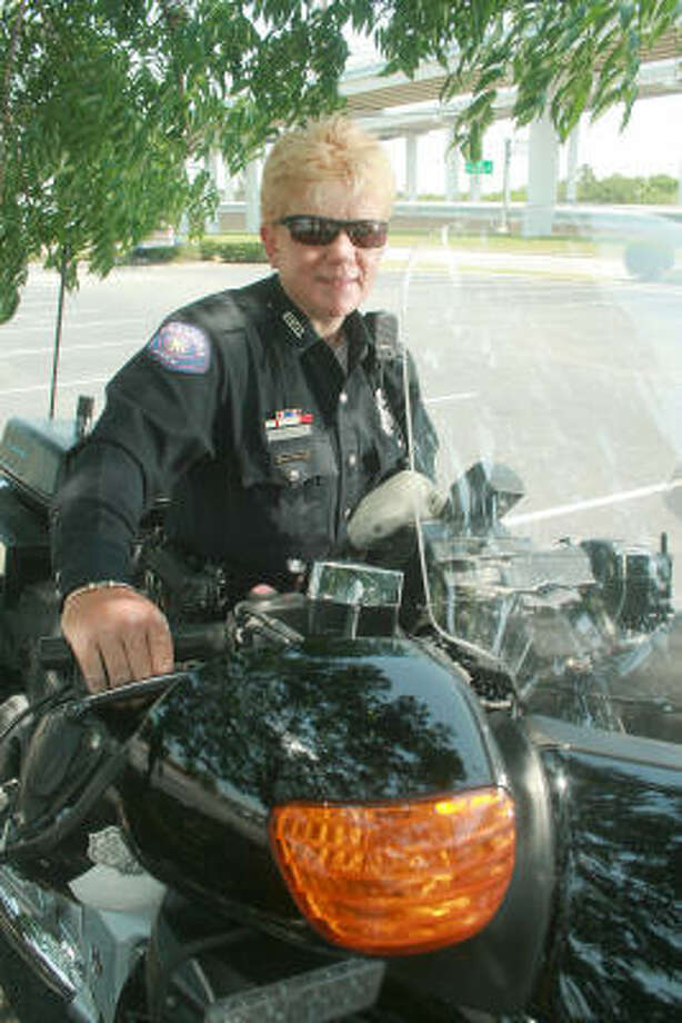RIDING HER STEEL HORSE:Officer Simone Riddle is the Pasadena Police Department's first and only female motorcycle cop. Photo: Pin Lim, For The Chronicle
