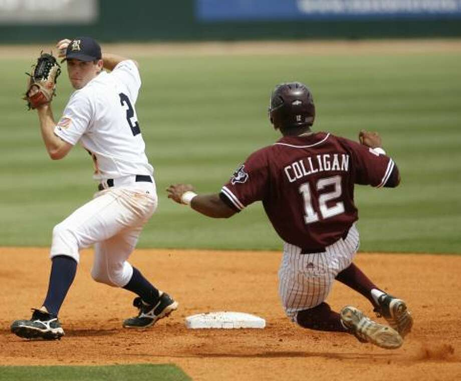 Rice's Jimmy Comerota, left, turns the double play after forcing out Texas A&M's Kyle Colligan (12) on a ball hit by Jose Duran in the third inning of Saturday's game. Photo: Karen Warren, Chronicle