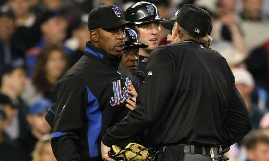 Disputes like this one over a Carlos Delgado foul ball in New York could be settled by replays. Photo: Al Bello, Getty Images