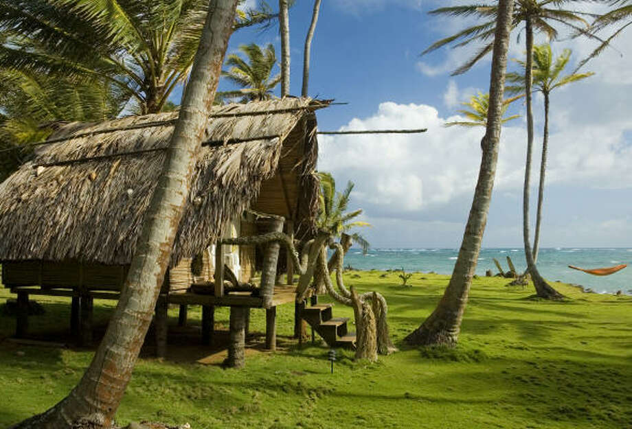 Idyllic thatched-hut bungalows at Derek's Place on Little Corn Island are just one of many surprises along Nicaragua's Caribbean Coast. Photo: Margie Politzer, Lonely Planet Images