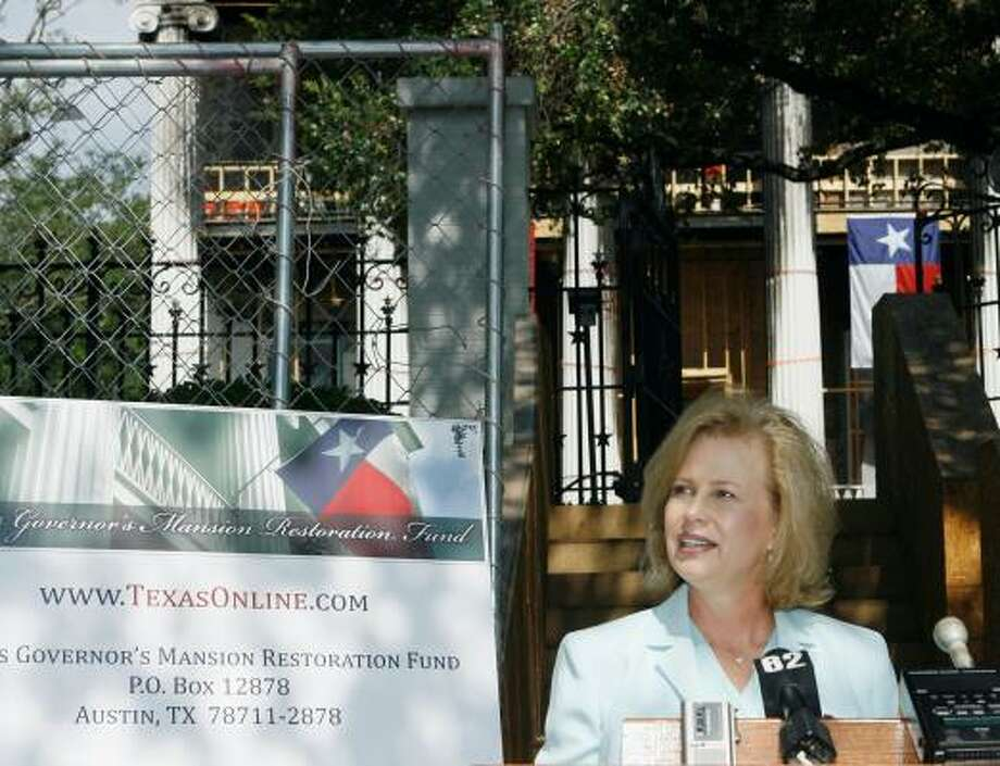 Texas first lady Anita Perry announces the formation of the Texas Governor's Mansion Restoration Fund to raise money to restore the 152-year-old structure after it was damaged by an arsonist. Photo: HARRY CABLUCK, ASSOCIATED PRESS