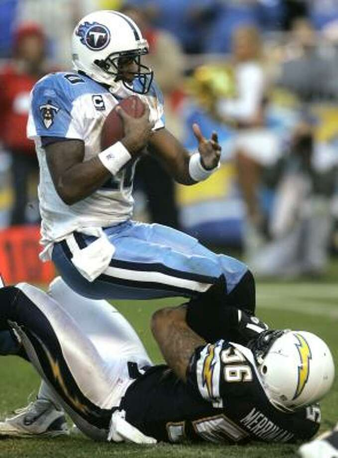 Chargers linebacker Shawne Merriman holds on tight to throw Vince Young for a loss. Photo: LENNY IGNELZI, ASSOCIATED PRESS