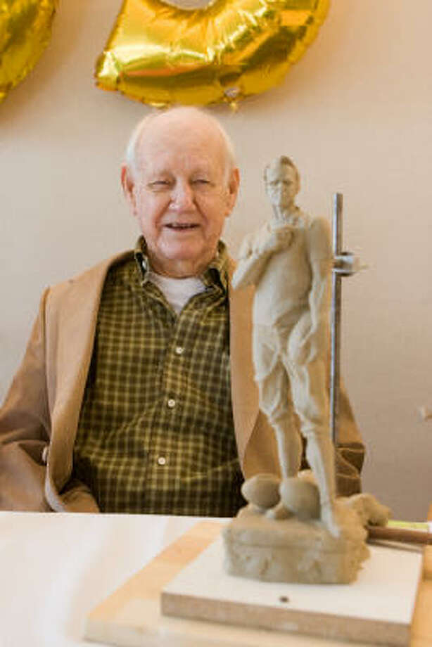 Curtis ``Dike'' Rose shows off the clay scale model depicting him when he coached San Jacinto High School to the 1949 city football championship. It will be used by sculptor Garland Weeks as the basis of a life-sized bronze sculpture to be installed on the Austin Street grounds of the former high school. Photo: R. Clayton McKee, For The Chronicle