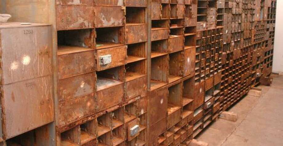 These Katrina blasted safe-deposit boxes were salvaged from a Chase branch bank in December 2005 in Louisiana. Photo: DONALD STOUT, FILE PHOTO