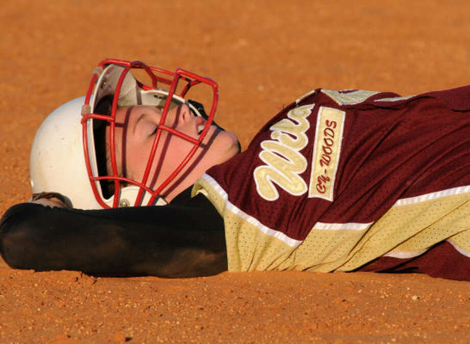 Cy Woods junior outfielder Rachel Stanford catches her breath after getting thrown out at third base against Jersey Village. Photo: Jerry Baker, For The Chronicle