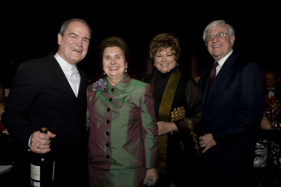 Taking center stage at the Houston Symphony Maestro's Wine Dinner onstage at Jones Hall are Hans Graf, from left, Helen Shaffer, dinner chair Charlotte Rothwell and Jim Shaffer. Photo: Jeff Fitlow, Houston Symphony