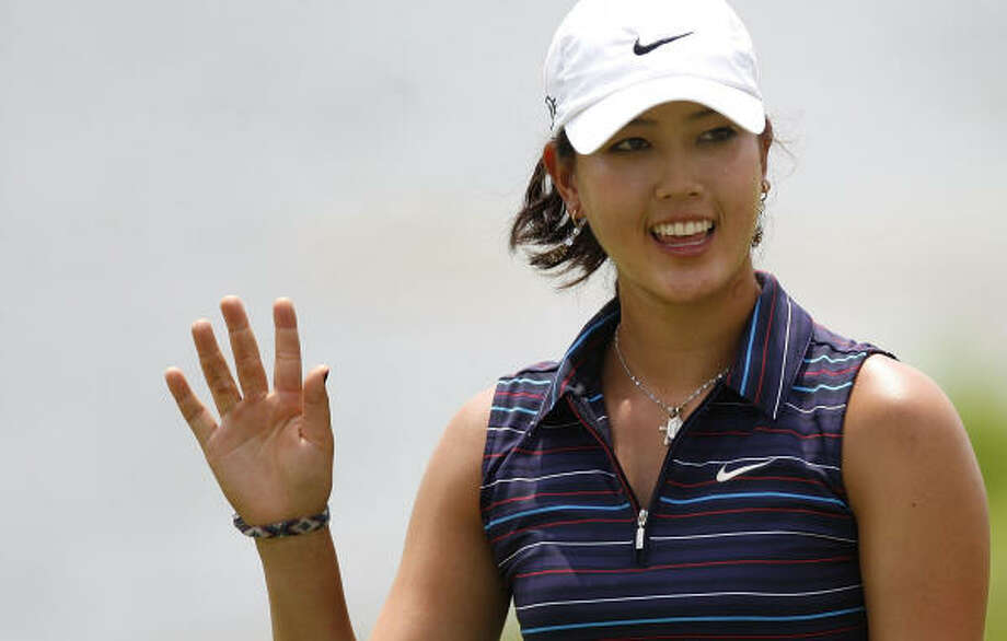 Michelle Wie, who was disqualified from her LPGA event over the weekend, will play on the PGA Tour for the first time in 2008 next week. Photo: Gregory Shamus, Getty Images