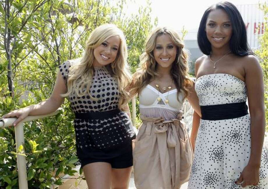 "Sabrina Bryan, left, Adrienne Bailon and Kiely Williams hang out in real life, too. ""We're totally not that catty girl group,"" Bailon says. Photo: MATT SAYLES, ASSOCIATED PRESS"