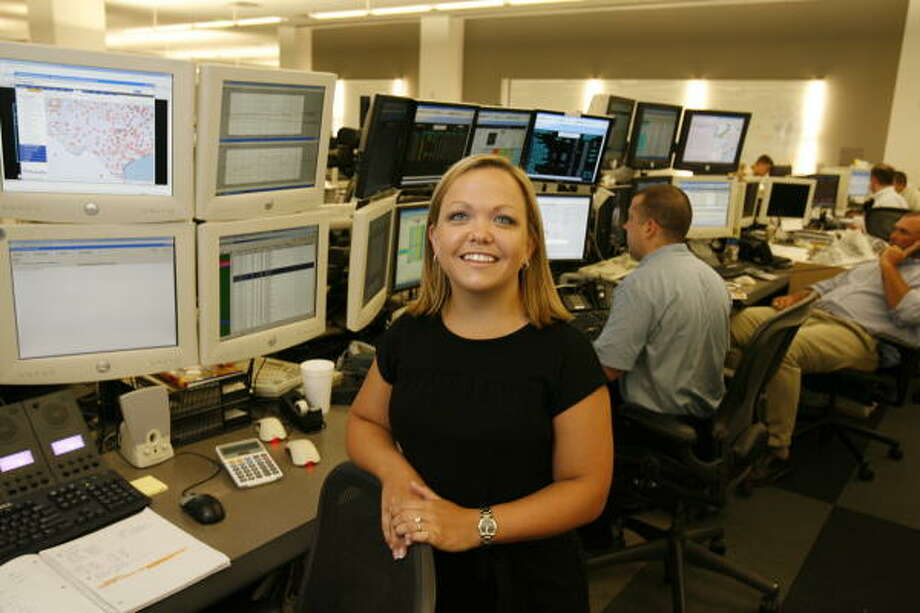 "Stephanie Hill, a real-time electricity trader for Calpine, poses on the trading floor, Tuesday, July 29, 2008,. ( Buster Dean / Chronicle ) ""One of my first days on the job with my old company was April 17, 2006. I was like, 'Oh my God, oh my God, what do I do?' People were trying to find power any way they could, ERCOT was calling to tell us 'Deploy this, deploy that.' You get real seasoned real quick when you have something like that happen. Those are days to remember because it's just pure chaos."" Photo: Buster Dean, Houston Chronicle"