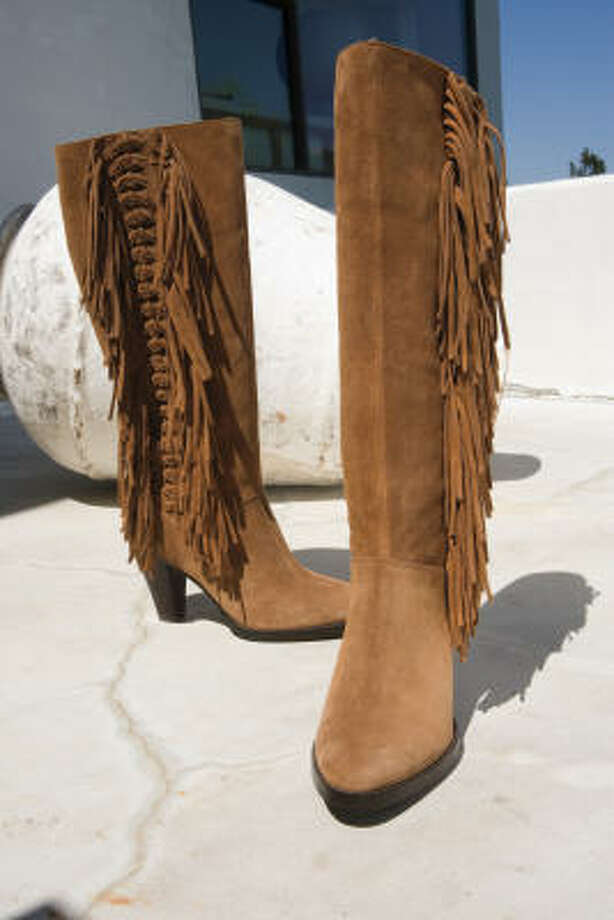 "The Michael Kors ""Dakota"" boot in tan suede with fringe detail is $249 at Macy's. Photo: Macy's"