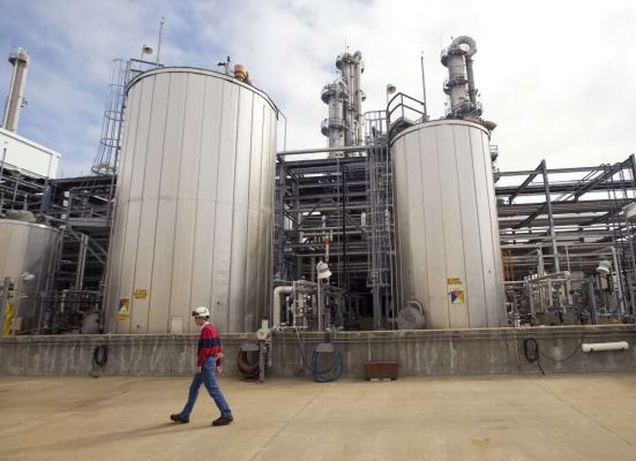 Chemical plants, including the BASF facility in Freeport, are cutting production because of slowing demand. Photo: BRETT COOMER, HOUSTON CHRONICLE