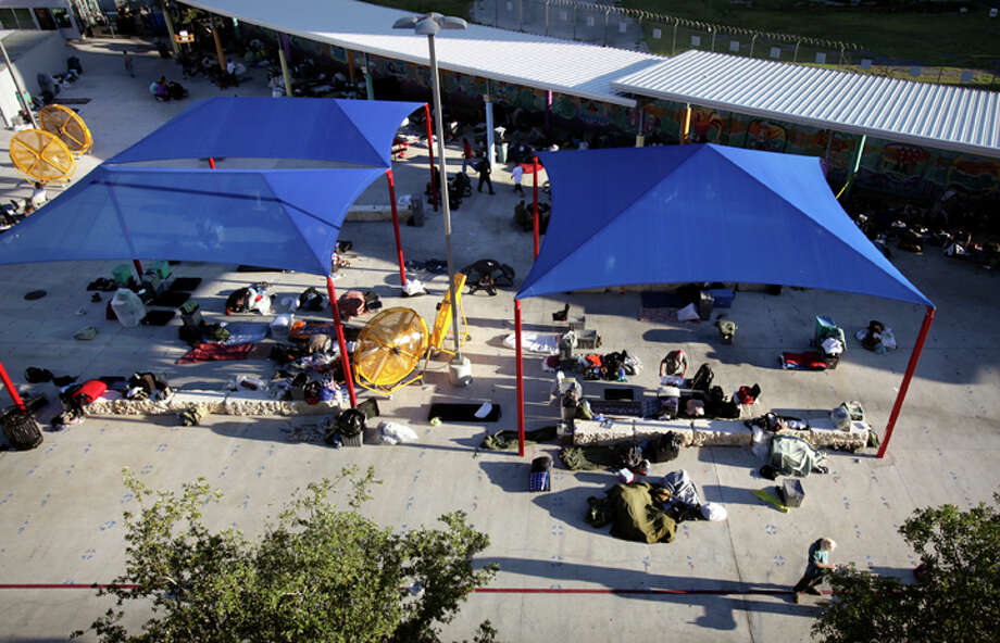 Prospects Courtyard, the outdoor sleeping area at Haven for Hope, regularly hosts more than 600 people a night. That's 200 more people than was originally anticipated. Photo: Bob Owen/rowen@express-news.net / rowen@express-news.net
