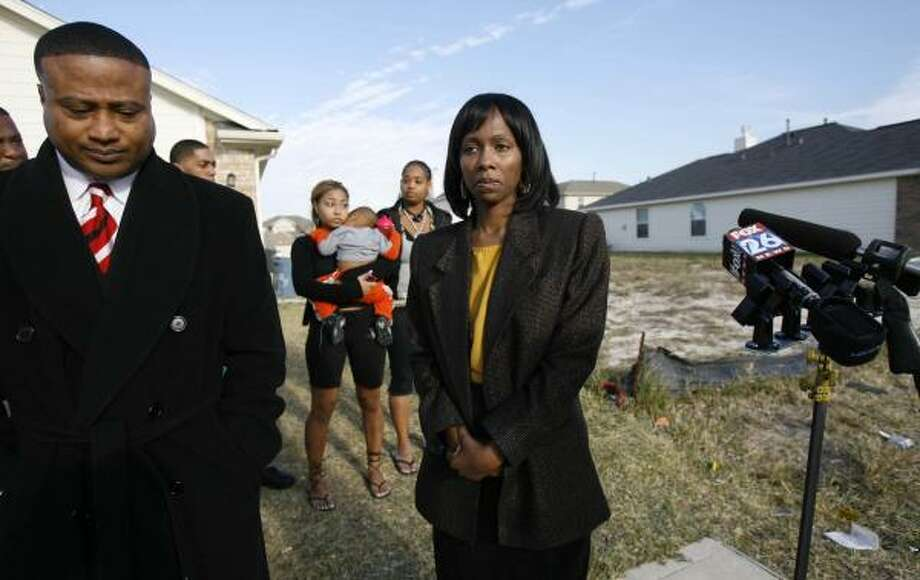 The home of Elvira Bowie, right, was spray-painted with racist words. Quanell X, left, on Thursday called on law enforcement to identify the incident as a hate crime. Photo: MELISSA PHILLIP, CHRONICLE