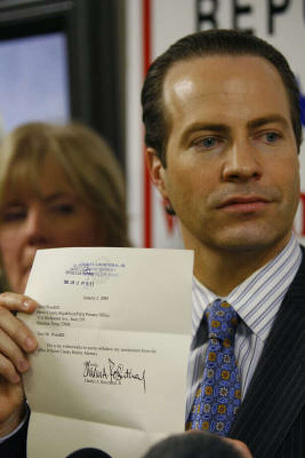 County GOP Chairman Jared Woodfill, displaying Chuck Rosenthal's letter of withdrawal from the primary, called for his resignation. Photo: Steve Ueckert, Chronicle